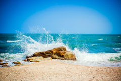 Big waves breaking on the shore with sea foam Royalty Free Stock Photos