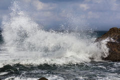 Big waves breaking on shore - wave splashing on rock Stock Image