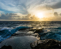 Big waves breaking and splashing on the rocks Stock Images