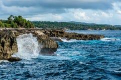 Big waves breaking and splashing on the rocks Stock Image
