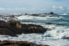 Big waves broken near stone seashore of France Stock Image