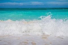 Big waves and clear blue sky. Ocean waves and beach scenery. royalty free stock photography