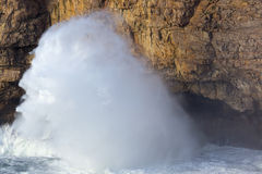 Big waves on cliff Stock Images
