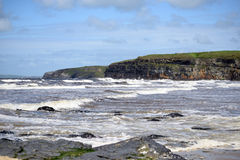 Big waves and cliffs on the wild atlantic way Stock Photos