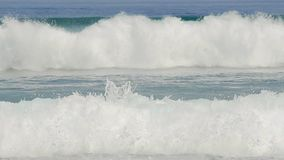 Big waves crash green sea. Two big waves crashing in green clear ocean waters in slow motion stock video