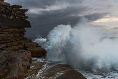 Big waves crashing against cliffs Royalty Free Stock Photo
