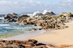 Big waves crashing on rocks coastline royalty free stock images