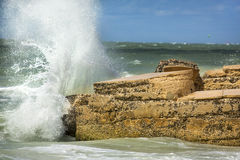 Big waves crashing into ruins of Bigelow Battery, Florida. Waves of a heavy surf break with explosive force on concrete remains of Battery Bigelow at Fort De Royalty Free Stock Photography