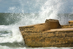Big waves crashing into ruins of Bigelow Battery, Florida. Waves of a heavy surf break with explosive force on concrete remains of Battery Bigelow at Fort De Stock Photo