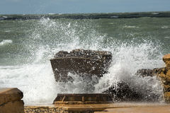 Big waves crashing into ruins of Bigelow Battery, Florida. Waves of a heavy surf break with explosive force on concrete remains of Battery Bigelow at Fort De Stock Image