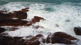 Big waves crashing on stone beach. Big waves crashing on a stone beach stock footage
