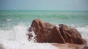 Big waves crashing on stone beach. 1920x1080. Big waves crashing on stone beach. The waves are rolling on a pebble stone beach. 1920x1080 stock video footage
