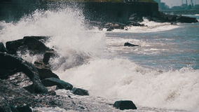 Big Waves Crashing on Stone Beach. Slow Motion. In 96 fps. Large storm waves crashing on rocky inlet pier. Sea Storm. The waves are rolling on a pebble stone stock video footage