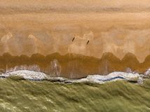Big waves crashing to the beach aerial view top down royalty free stock photography
