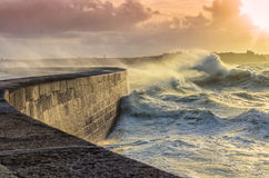 Big waves crushing on stone pier Stock Photography