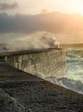 Big waves crushing on stone pier Royalty Free Stock Photo