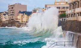 Crushing waves in Saint Malo stock images
