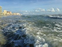 Big Waves with Foam Rolling on Daytona Beach at Daytona Beach Shores, Florida. Stock Photography