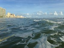 Big Waves with Foam Rolling on Daytona Beach at Daytona Beach Shores, Florida. Stock Photo