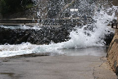Big waves in harbour in Collioure. High waves in the harbour of Collioure along a walking-path. A big chance to get very wet stock images