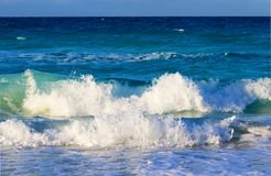 Big waves hitting the beach in the Caribbeans stock photo