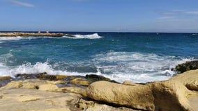 Big waves in Malta city Sliema. Rocky shore at day time. Big waves in Malta city Sliema stock video