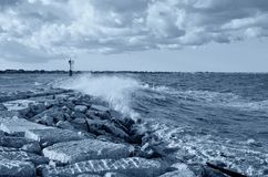 Big waves over the pier Royalty Free Stock Image