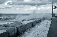 Big waves over the pier Royalty Free Stock Photo