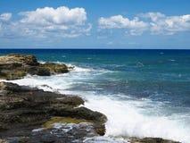Big waves on rock coast blue sea and sky on Crete Stock Photo