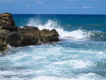 Big waves on rock coast blue sea and sky on Crete Royalty Free Stock Photography