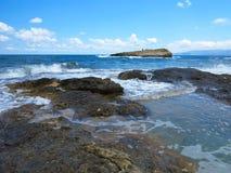 Big waves on rock coast blue sea and sky on Crete Stock Image