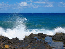 Big waves on rock coast blue sea and sky on Crete Stock Images