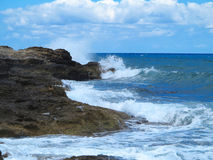 Big waves on rock coast blue sea and sky on Crete Royalty Free Stock Images