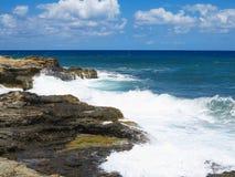 Big waves on rock coast blue sea and sky on Crete. Greece Stock Image