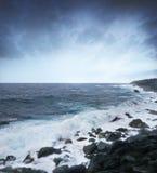Big waves and rocks. Big ocean waves and black rocks Royalty Free Stock Image
