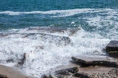 Big waves on rocky coast and blue sea Royalty Free Stock Photo