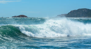 Big waves on the sea. With mountains background royalty free stock photo