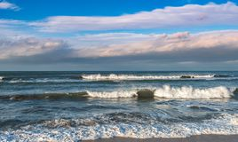 Waves on storming sea stock images