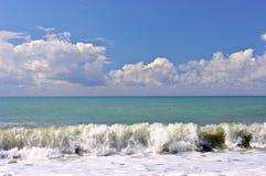 Big waves of surf on the sea coastline Stock Image