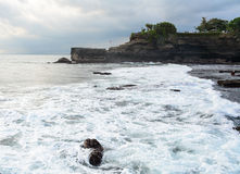 Big waves at Tanah Lot cliff in Bali, Indonesia Stock Images