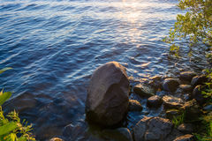 Big wet rocks on the shore of the river. Royalty Free Stock Photo