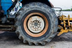 Big wheel of Agricultural tractors And the industry. Stock Photos