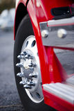 Big wheel aluminum reflection bolts rims red semi truck Stock Photos