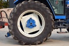Big wheel of a farm tractor. Big wheel of black rubber, part of a agricultural tractor on a farm in Groningen Stock Photos