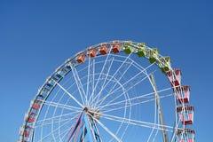 Big Wheel on Blue Sky. Colorful Amusement Park Big Wheel on Clear Blue Sky Royalty Free Stock Image