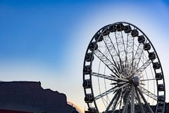 Big wheel, Cape Town, in backlight with Table Mountain Royalty Free Stock Photography