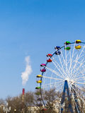 Big wheel. The big wheel costs on the bank of the sea gulf Royalty Free Stock Photos