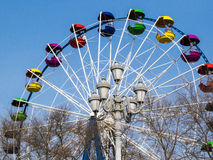 Big wheel. The big wheel costs on the bank of the sea gulf Stock Images