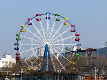 Big wheel. The big wheel costs on the bank of the sea gulf Stock Photo