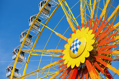 Big wheel in front of blue sky Stock Photos
